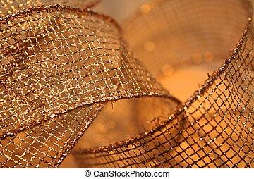 Sparkling Gold Ribbon - Macro of sheer mesh gold ribbon with...
