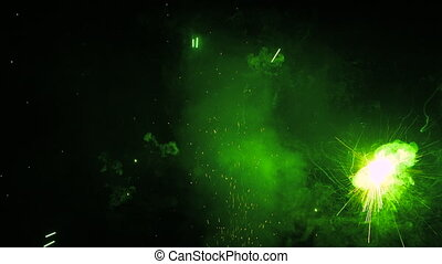 Sparkling green fireworks on black background during celebrating holiday of saint patrick. Perfect for creating video effects, digital compositing.