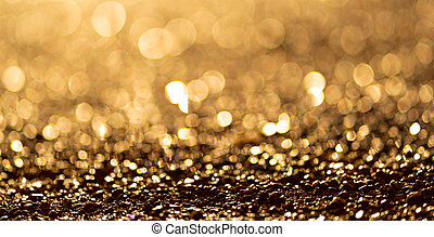 Sparkling light boke blur. Golden glitter particles background.