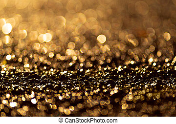 Sparkling light boke blur. Sea pebbles.