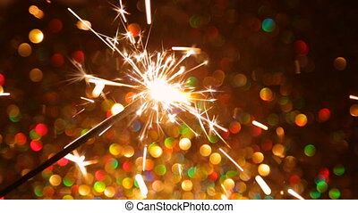 Sparkling New Year's fire on the background of the bokeh -...