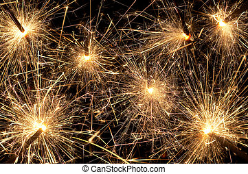 Sparkling night - Frame filled with fire sparkles and...