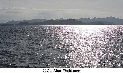 Sparkling sea - Sea sparkling with reflected light of sun in...