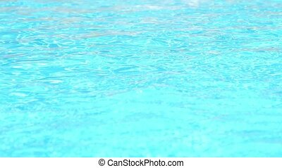 Sparkling Splashes of Water in Swimming Pool. Speed up.