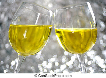 Sparkling toast - Glasses chink together against a dreamy ...