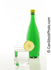 Sparkling Water - A glass of sparkling water with a slice of...