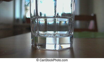 Sparkling water poured in a glass