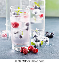 Sparkling water with berry and herb ice - Sparkling water...
