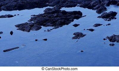 Sparkling waves on sandy beach,reef