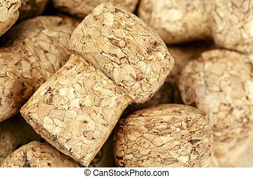 Sparkling wine bottle cork, shown close up against...