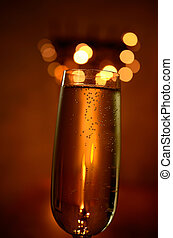 Sparkling wine - Glittering sparkling wine with blurred...