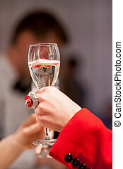 Sparkling wine in a woman's hand
