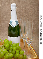 Sparkling wine with grapes and wine glasses