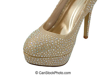 Sparkly toe of a gold fashionable high-heeled shoe