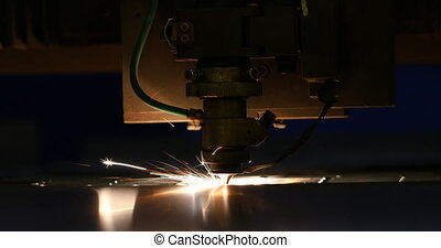 Sparks fly out machine head for metal processing laser metal...