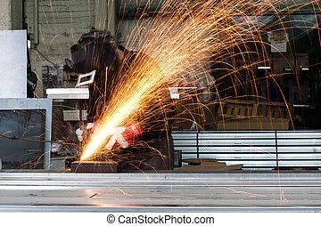 workshop - sparks flying during grinding in a metal workshop