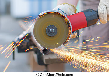 Sparks flying metal cutting abrasive disk.