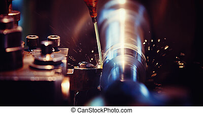 sparks flying while machine griding and finishing metal in...
