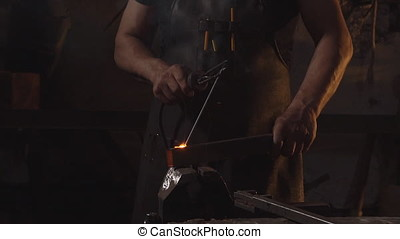 Sparks from a welding machine close-up. Slow motion.