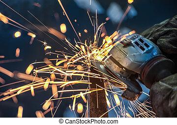 African man grinding metal