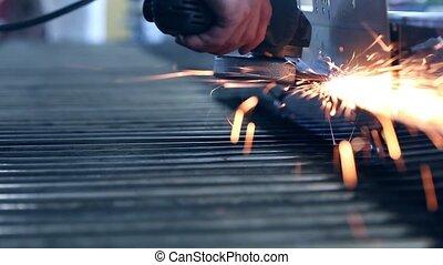Sparks from grinder at workshop - Sparks from an industrial...