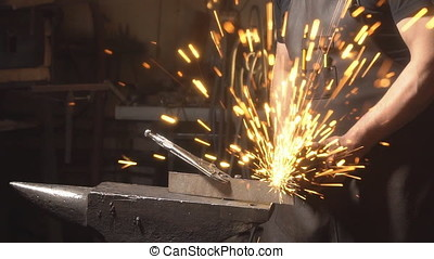 Sparks from grinder cutting metal. Slow motion - Sparks from...