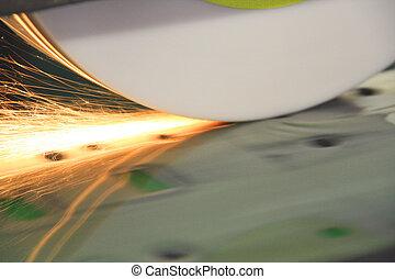 Sparks from Grinder on Die, showing coolant - Grinder...