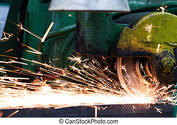 Sparks from grinding machine. Industrial, industry