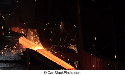 Sparks from the cutting of the red-hot billet circular saw 5