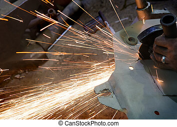 sparks from the grinder