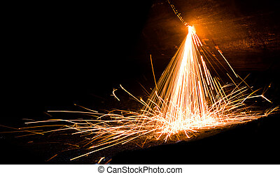 Sparks from welding of metal