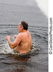 Sparks in ice water - Traditional winter swimming for a...