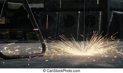 Sparks of welding falling on the floor