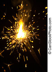 sparking Bengal fires on black background close-up