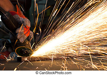 sparks while grinding in a steel factory