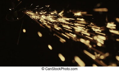 sparks while grinding - sparks frying on the black...