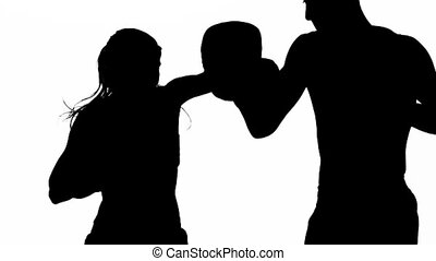 Sparring between athletes. Silhouette. White background....