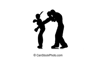 Sparring between kickboxing. Silhouette. White background....