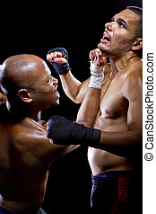 Sparring Fighters - sparring mma fighters or boxers punching...