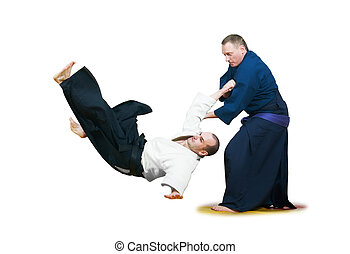 Two jujitsu fighters sportsmen at unarmed combat technique training on mat