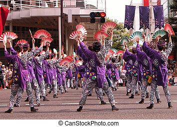"Group of women dancing ""sparrow dance"" during Aoba Street festival, Sendai, Japan. Natural lighitng and reflections Group of women dancing ""sparrow dance"" during Aoba Street festival, Sendai, Japan. Natural lighitng and reflections"