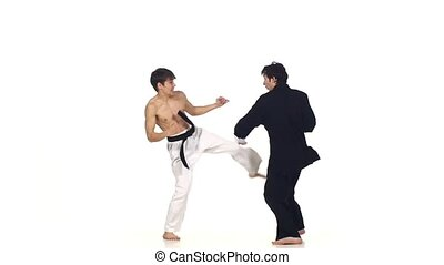 Sparrynh taekwondo and wushu or karate man. on a white, blows from each other, Slow motion