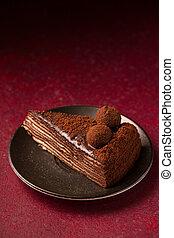 Spartacus cake on a burgundy background