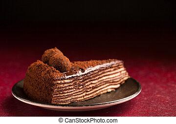 chocolate cake on a burgundy background