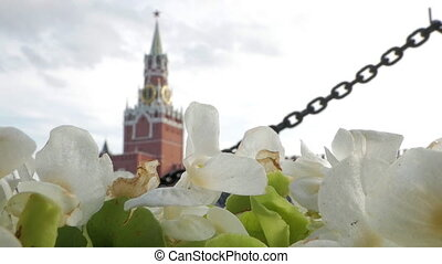 Spasskaya Tower of Kremlin in the background shot through summer white flowers. Red Square and Kremlin are favourite tourist spots in Moscow
