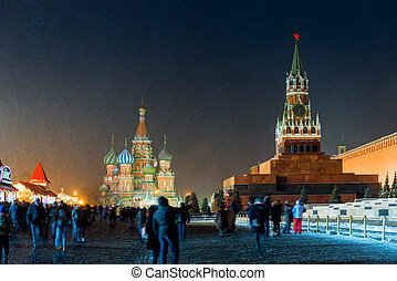 Spasskaya tower of the Kremlin and St. Basil's Cathedral in...