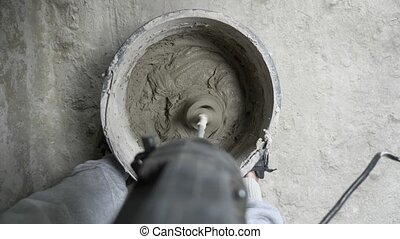 spatula and bucket with mortar on the construction site. the...