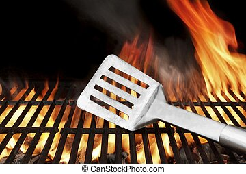 Spatula on the Flaming BBQ Grill