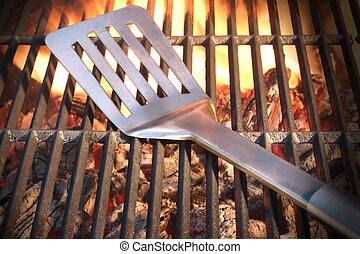 Spatula On The Hot Flaming Grill Close-up