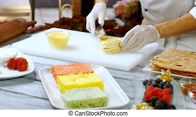 Spatula quickly puts cream. Shortcake covered in yellow...